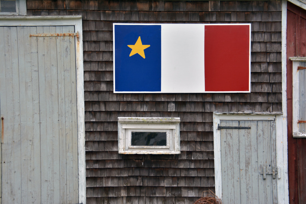 Along the Eastern Shore of NS, discover Acadian pride on the side of a barn Grand Desert, NS .