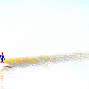 Surfer at Lawrencetown Beach, NS by Picture Perfect Tours