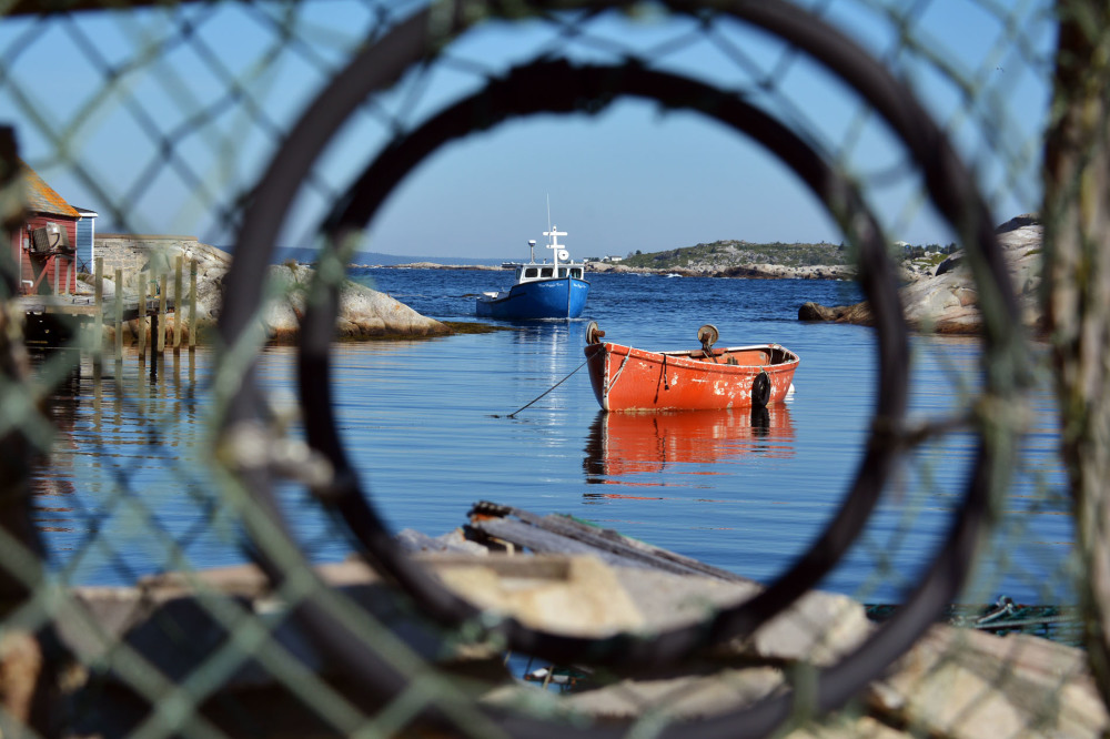 Iconic fishing village of Peggy's Cove seen through a lobster trap by Picture Perfect Tours