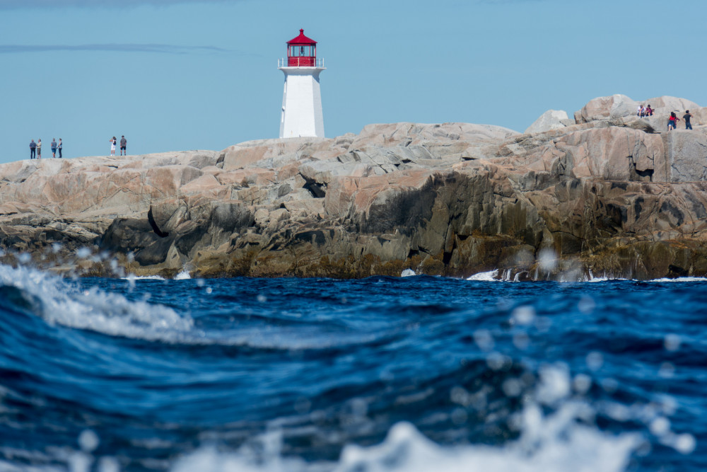 Water view of the famous lighthouse at Peggy's Cove, NS